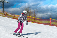 Skier on the slope in sunny day Stock Image