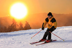 Skier on a slope at sunset. On a sharp turn Royalty Free Stock Image