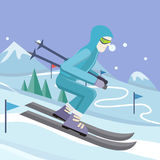 Skier on Slope Vector Illustration in Flat Design. Skier on slope vector illustration. Flat design. Man in ski suit sliding from hill with slalom flags. Winter Stock Photo