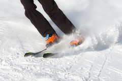 Skier on the slope. Winter sport activity Royalty Free Stock Image