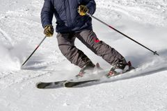 Skier on the slope. Winter sport activity Stock Images