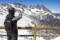 Skier Smartphone Shot Video Landscape Mountain. Back View of young skier man taking video or shot with smartphone of mountain dolomites trentino snow Stock Photography