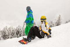 Skier and Snowboarder on mountain Royalty Free Stock Photos
