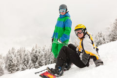 Skier and Snowboarder on mountain Royalty Free Stock Photo