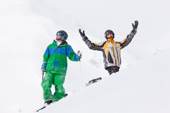 Skier and Snowboarder on mountain Stock Images