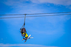 Skier and snowboarder sitting in ski lift Stock Photo