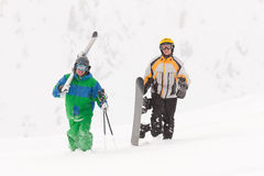 Skier and snowboarder in the snow Royalty Free Stock Image