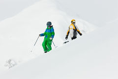 Skier and snowboarder in the snow Stock Image