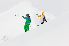 Skier and snowboarder in the snow Stock Photography