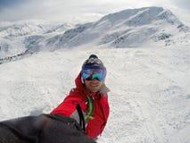 Skier on snowing mountain Royalty Free Stock Photo