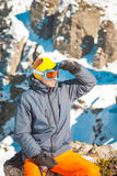 Skier sportsman at mountain cliff with a panoramic background. Skier at mountain cliff with a panoramic background stock image