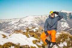Skier sportsman at mountain cliff with a panoramic background. Skier at mountain cliff with a panoramic background royalty free stock photos