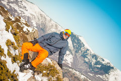 Skier sportsman at mountain cliff with a panoramic background Stock Image