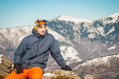 Skier sportsman at mountain cliff with a panoramic background. Skier at mountain cliff with a panoramic background stock photo