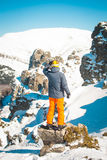 Skier sportsman at mountain cliff with a panoramic background Royalty Free Stock Photos