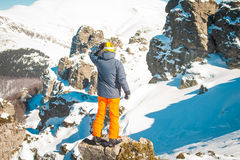 Skier sportsman at mountain cliff with a panoramic background. Skier at mountain cliff with a panoramic background royalty free stock photography