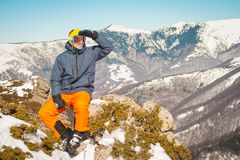 Skier sportsman at mountain cliff with a panoramic background Royalty Free Stock Image