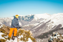 Skier sportsman at mountain cliff with a panoramic background Royalty Free Stock Photography