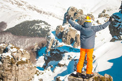 Skier sportsman at mountain cliff with a panoramic background Stock Photo