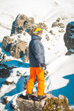 Skier sportsman at mountain cliff with a panoramic background. Skier at mountain cliff with a panoramic background royalty free stock image