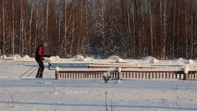 Skier in sportswear and mask rides on track stock footage