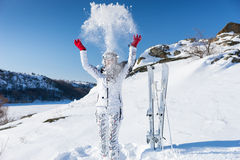 Skier in spray of snow on hill Stock Photos