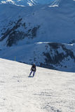 Skier standing in front of mountains Royalty Free Stock Photos