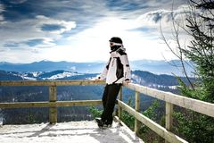 Skier standing on the observation deck with Stock Photo