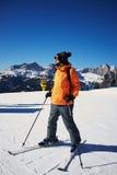 Skier standing on the ski slope Royalty Free Stock Photos