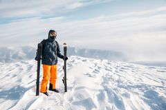 Skier standing on mountain top Royalty Free Stock Photography