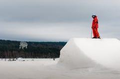 Skier standing on springboard peak Royalty Free Stock Images