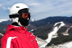 Skier standing on top of a mountain Stock Photography