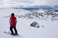 A skier standing on top of a ski slope in Perisher in Australia stock images