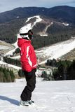 Skier stands on top of the mountain Royalty Free Stock Images