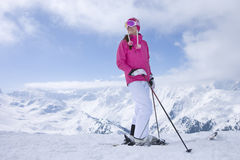 Skier stopping on mountain top looking at mountains Stock Photos