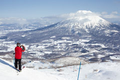 Skier takes a photo of Mt Yotei Stock Image
