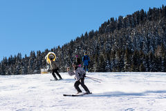 A skier is taking a selfie or filming himself while riding down the slope Stock Images