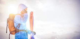 Skier talking on mobile phone Royalty Free Stock Images