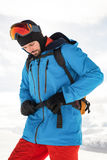 Skier tightening his backpack belt Royalty Free Stock Image