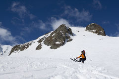 Skier about to jump in a mountain Stock Images