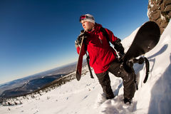 Skier on a top. Over blue sky Stock Photo