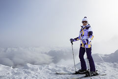 Skier on top of the Aibga Ridge Royalty Free Stock Image