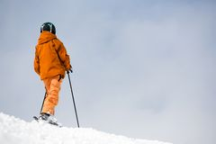 Skier on top of the mountain Royalty Free Stock Photo
