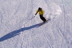 Skier at the turn. A man is skiing at a ski resort Stock Photos