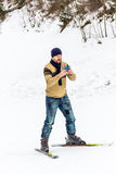 Skier using his smart phone Stock Photo