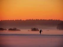 Skier walking against of beautiful sunset Stock Image