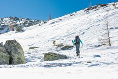 Skier walking on a trail. Ski touring is a winter off-piste sport Royalty Free Stock Photos