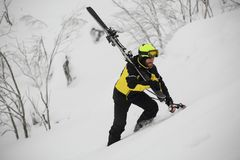 Skier walks in the mountains Stock Image