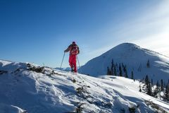 A skier walks in the mountains Stock Photos