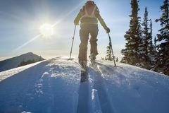 A skier walks in the mountains Royalty Free Stock Image